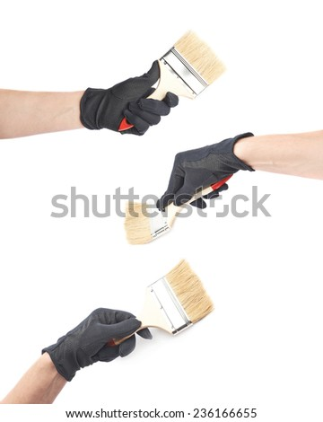 Hand in a black working glove holding a paint brush, composition isolated over the white background, set of three different foreshortenings