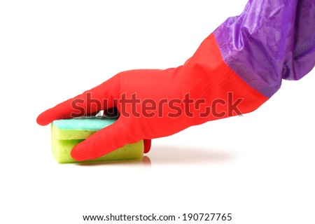 Hand in a rubber glove cleaning a white surface with a sponge - stock photo