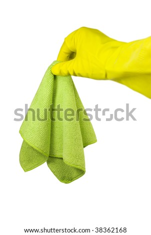 Hand in a yellow rubber glove and a green rag. On a white background - stock photo