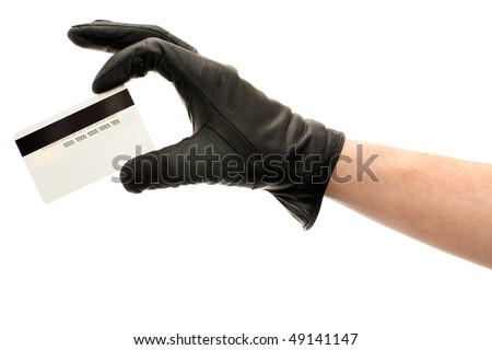 Hand in black leather glove holding credit card, isolated on white background - stock photo