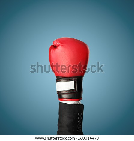 hand in boxing gloves isolated on blue - stock photo