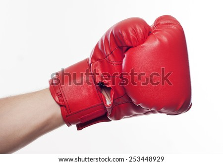 Hand in boxing gloves over white background - stock photo