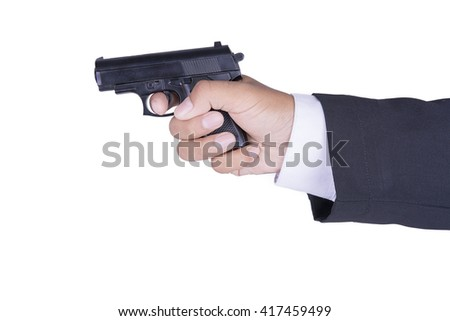 hand in business suit holding gun selective focus