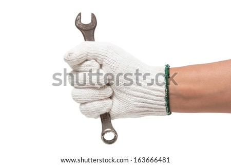 Hand in glove holding a spanner isolated on a white background - stock photo