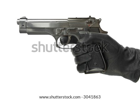 Hand in glove with pistol, isolated on white - stock photo