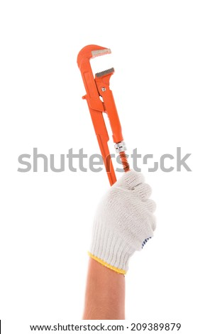 Hand in gloves holding wrench. Isolated on a white background.