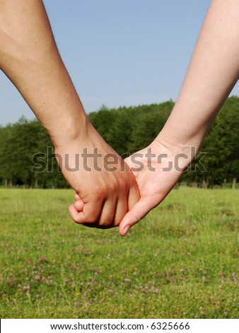 Hand-in-hand. Couple love in autumn scenery - stock photo