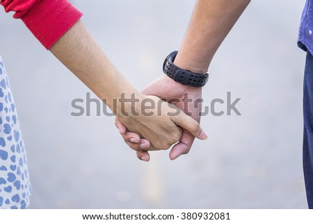 Hand in Hand with Love - You're never walk alone - stock photo