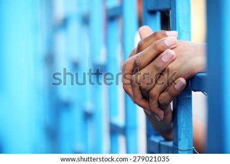hand in jail - stock photo
