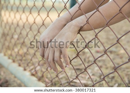 Hand In Jail, concept of life imprisonment  - stock photo