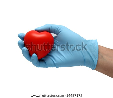 hand in latex blue gloves holding a toy heart isolated in white