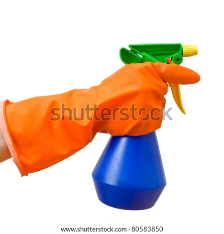 Hand in orange protective glove holding blue spray bottle on white background