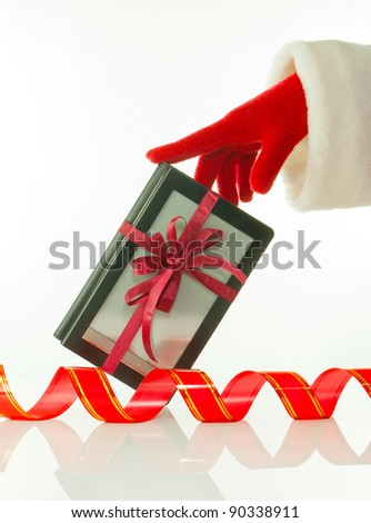 Hand in red glove holds electronic book reader against white background - stock photo