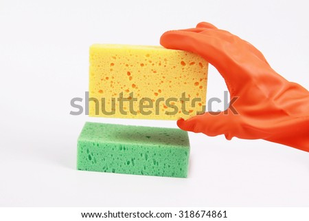 Hand in red glove with  sponge isolated on white background. - stock photo