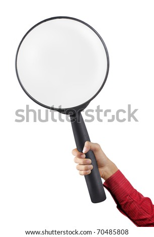 hand in red suit holding a big magnifier glass - stock photo