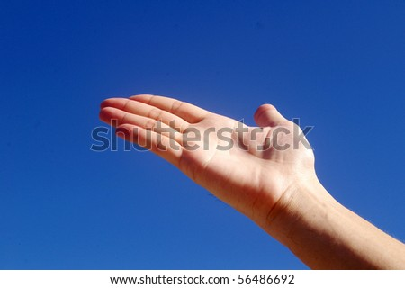 Hand in the blue sky