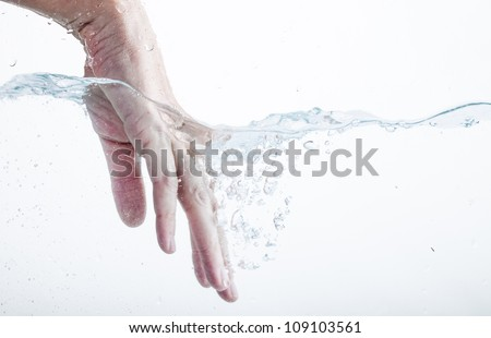 Hand in water - stock photo