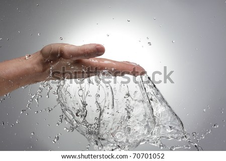 hand in water stream - stock photo