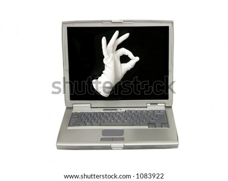 Hand in white fabric glove showing OK sign on the laptop screen - stock photo