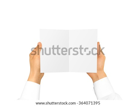 Hand in white shirt sleeve holding blank booklet card. Offset brochure opening presentation. Pamphlet hand man show paper. Sheet template. Booklet design. Fold paper display.