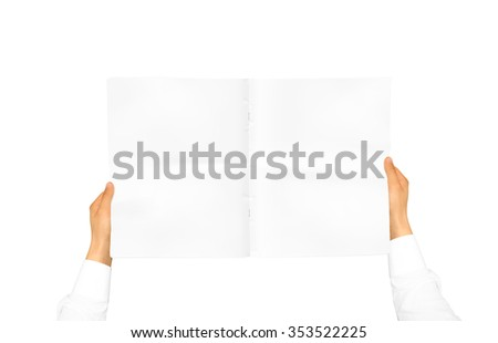 Hand in white shirt sleeve holding blank journal in the hand. Empty magazine presentation. Pamphlet hand man. Man show pages. Newspaper template. Booklet in hands. Book design. Catalog sheet display. - stock photo
