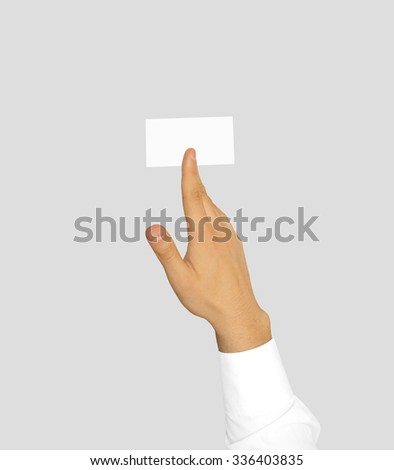 Hand in white sleeve shirt holding blank business card mock up. Businessman hold empty calling card paper isolated. Hands reaching space brochure template. Visiting card flyer logo design presentation - stock photo