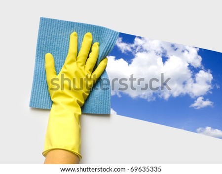 Hand in yellow glove with sponge - stock photo