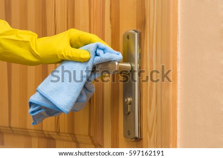 Hand in yellow protective glove with rag cleaning wooden door. Early spring cleaning or regular & Hand Yellow Protective Glove Rag Cleaning Stock Photo (Edit Now ...