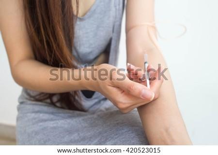 Hand injection drug - stock photo