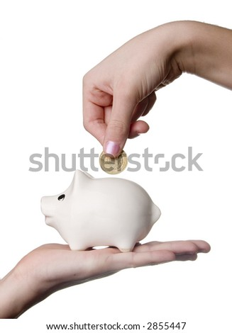 Hand inserting coin into piggybank placed on another hand over white background