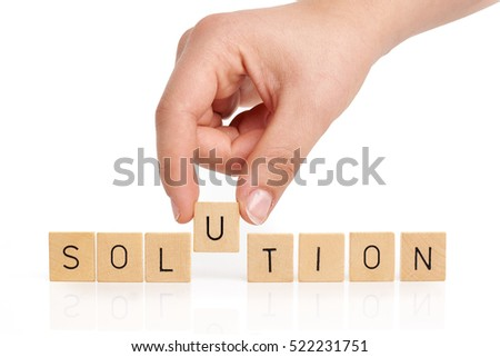 Hand is building the word solution on white background
