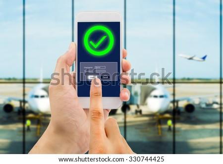 hand is entering password to buying flight tickets online - stock photo