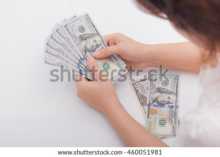 Hand is giving money isolated on white background. Business concept