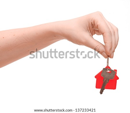 hand is handing a house key