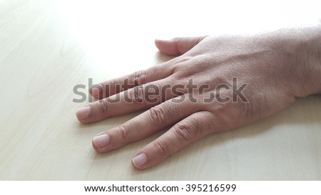 Hand is part of human arm which is used for grasping and holding. sometimes, it represents how tired you are. You want to leave yourself with a peaceful mode - stock photo