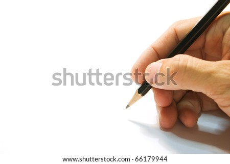 Hand is writing with black pencil