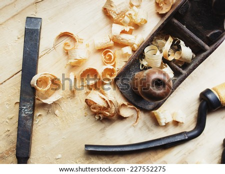 Hand jack plane and wood chips  - stock photo