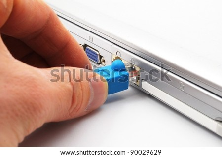 hand laptop and network connector showing lan or internet communication concept - stock photo