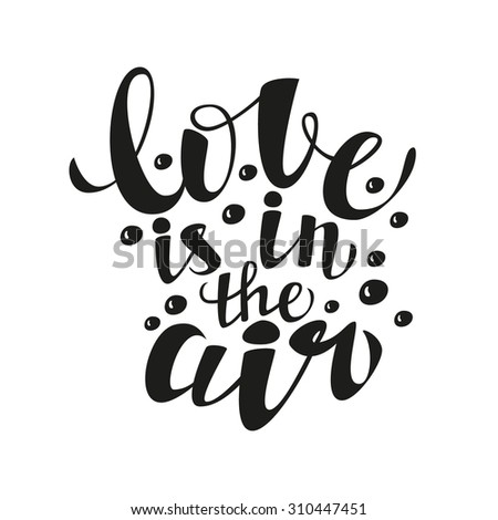 Hand lettering calligraphic typography poster.Romantic quote 'Love is in the air'.For greeting cards, postcards, posters, t-shirts and other decorations.Raster copy - stock photo