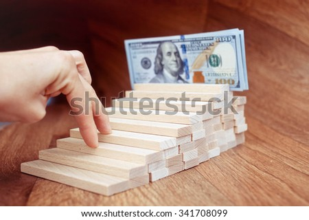 Hand liken business person rise a toy staircase to success, business concept. - stock photo