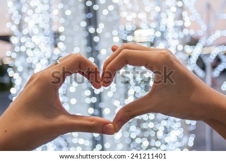 hand love heart and bokeh,love ,valentine concept. - stock photo
