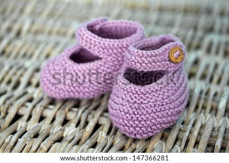 Hand-made baby shoes  - stock photo