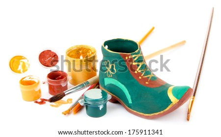 Hand made ceramic saint patricks day boot and color paints isolated on white - stock photo