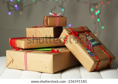 Hand-made Christmas gifts on bokeh background - stock photo