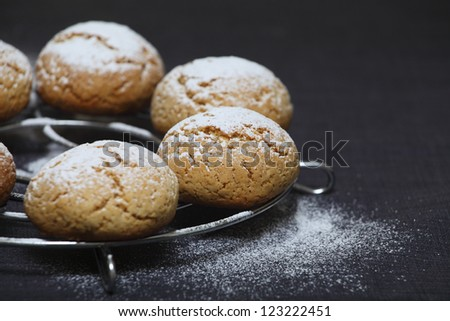 Hand-made Honey cookies under sugar powder - stock photo