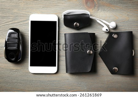 Hand made leather man accessories on white wooden background - stock photo