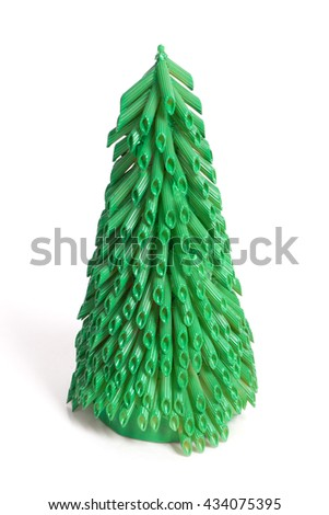 Hand-made new year tree from pasta isolated on white background