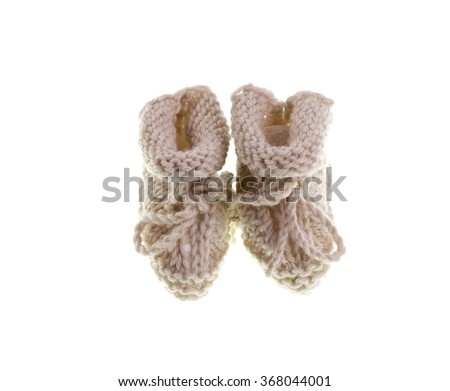 Hand-made pair of booties for a newborn baby - stock photo