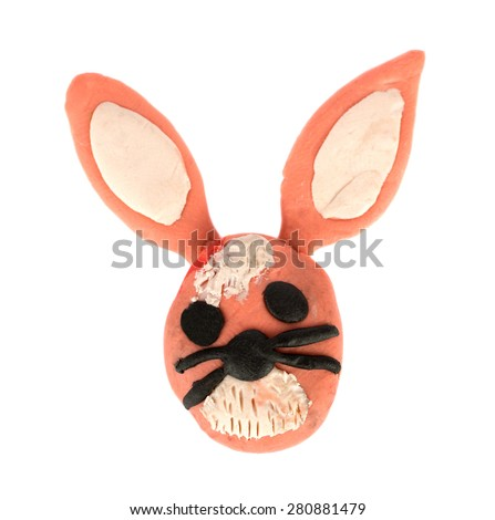 Hand made plasticine or modeling clay figure of a bunny on white background - stock photo