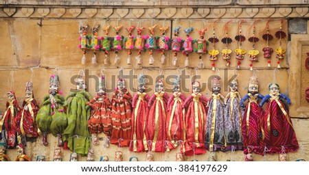 hand made puppets attached to string in Rajasthan India dolls. Women face with traditional Indian makeup wearing saree / sari - stock photo